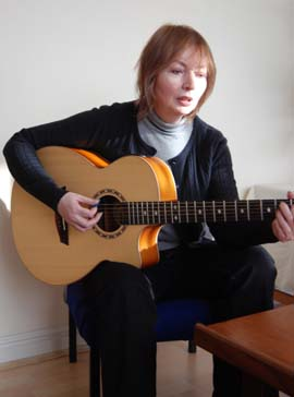 Mary Hopkin playing guitar in Space Studios' reception